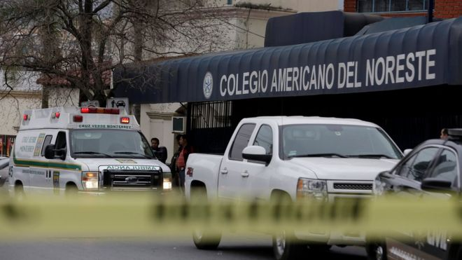 """A yellow police line cordons off access to the Colegio Americano del Noreste after a student opened fire at the American school, according to the state""""s security spokesman, in Monterrey, Mexico"""