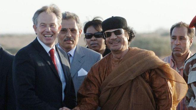 """File photo of Tony Blair and Muammar Gaddafi shaking hands Gaddafi""""s desert base near Sirte, Libya"""