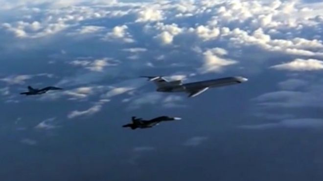 An archive picture of a Russian Tu-154 plane escorted by Russian Su-34 bombers