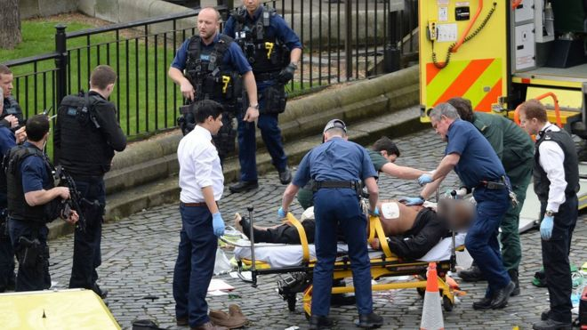 Man on a stretcher at Westminster