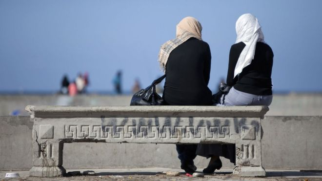 Two women sitting on a bench in Alexandria, Egypt