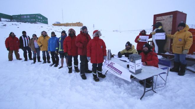 Australians based at the Davis station in Antarctica line up to cast their vote in the 2016 election