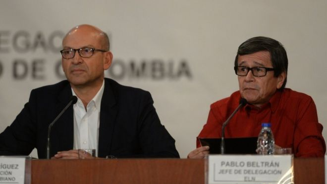 The Colombian government delegate and ELN delegate announce the beginning of the peace talks. (Photo Courtesy of BBC).