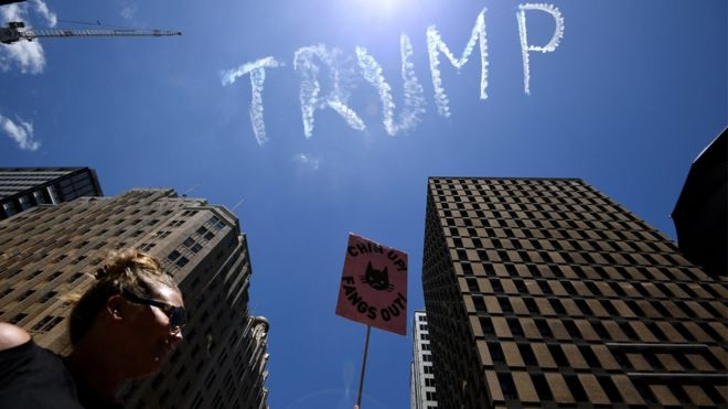 """A view of the skywriting word reading """"Trump"""" as thousands rally in support of equal rights in Sydney, New South Wales, Australia, 21 January 2017"""