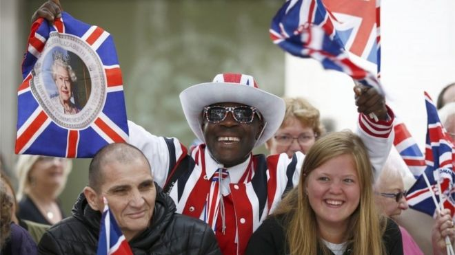 Well-wishers wait for the arrival of the Queen at a service of thanksgiving at St Paul's Cathedral in London.