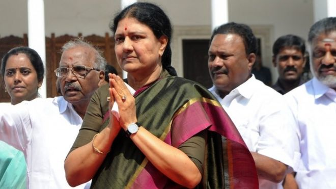 This file photo taken on December 31, 2016 shows VK Sasikala, general secretary of southern Tamil Nadu state's ruling All India Anna Dravida Munnetra Kazhagam (AIADMK), gesturing upon her arrival to take up office at the AIADMK headquarters in Chennai
