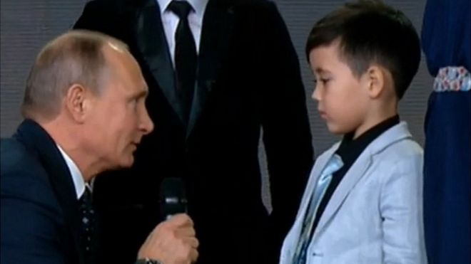 President Putin speaking to boy at geographical awards ceremony, 24 Nov 16