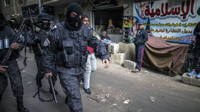 Egyptian police special forces patrol streets in al-Haram district of Giza on 25 January 2016
