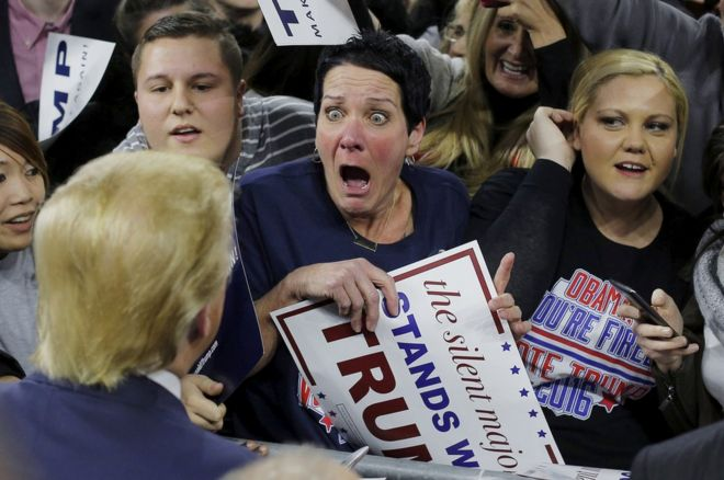 Audience member Robin Roy reacts as US Republican presidential candidate Donald Trump greets her at a campaign rally in Lowell, Massachusetts, 4 January 2016.