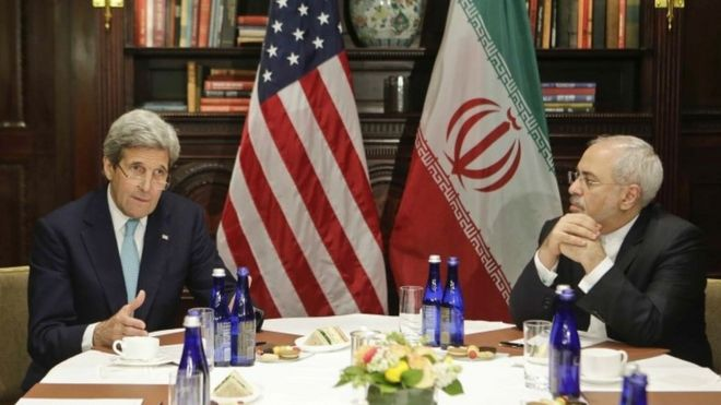 Secretary of State John Kerry speaks to the media as Iranian Foreign Minister Mohammad Javad Zarif listens in New York.