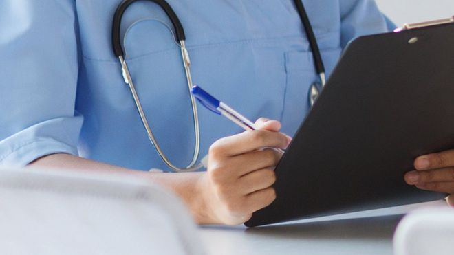 A nurse holding a clipboard