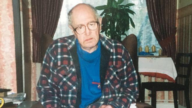 Phillip Hoe sat in his living room