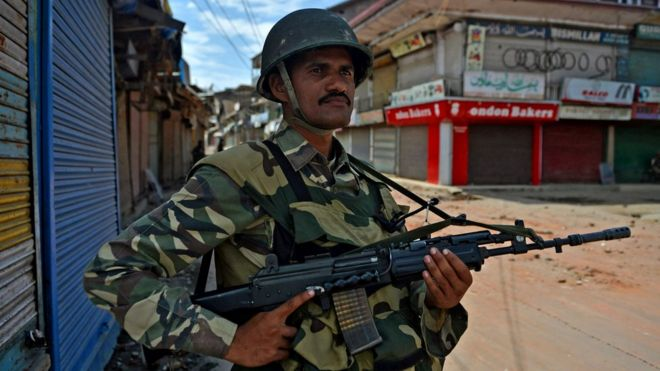 An Indian paramilitary trooper patrols in the Batmaloo Area of Srinagar on August 17, 2016