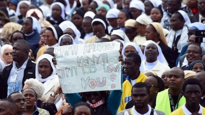 Catholic followers attend a mass by Pope Francis at the University campus in Nairobi, Kenya, 26 November 2015