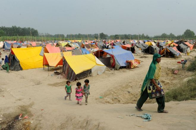 In this photograph taken on October 7, 2013 an Indian Muslim woman walks at a relief camp in Malakpur, a village in Shamli district of Uttar Pradesh.