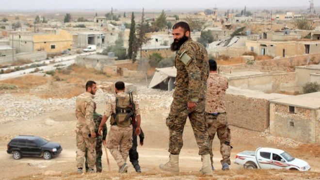 Syrian government forces in the village of Jabboul on the eastern outskirts of Aleppo (24 October 2015)