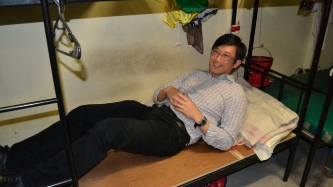 This photo uploaded by the Singapore Ministry of Manpower shows Minister of State Teo Ser Luck lying on a bed of a migrant construction worker