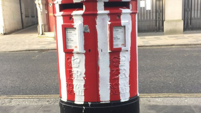The post box painted with Saints stripes in Bargate