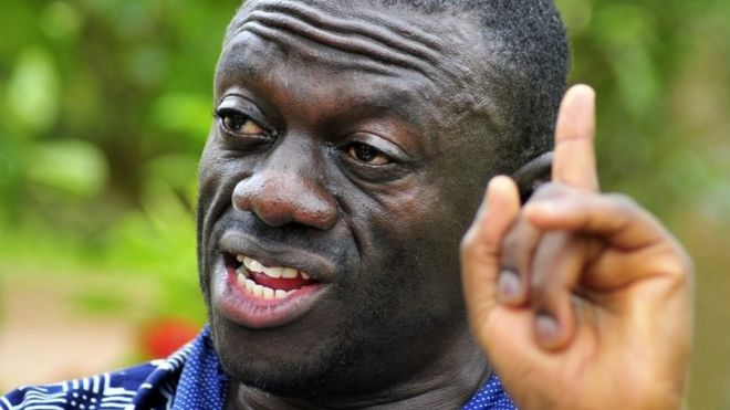 In this Wednesday, April 20, 2011 file photo, opposition leader Kiiza Besigye speaks during a rally in Kampala, Uganda