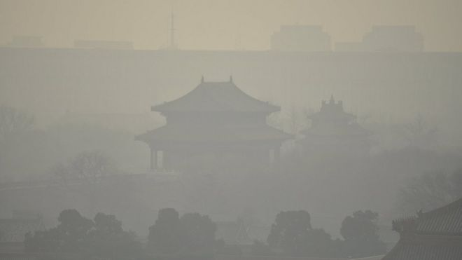 Buildings inside the Forbidden City are seen amid heavy smog under a red alert for air pollution, in Beijing, China, December 19, 2015.