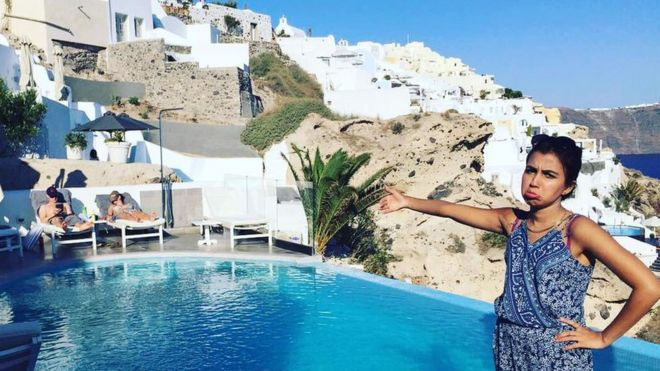 Huma Mobin by the pool in Santorini, Greece