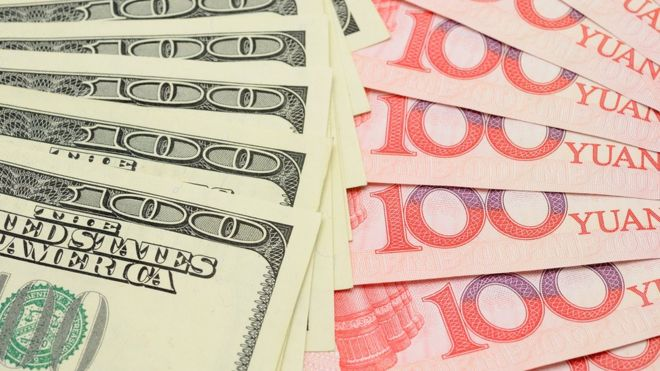 US dollars and Chinese yuan notes