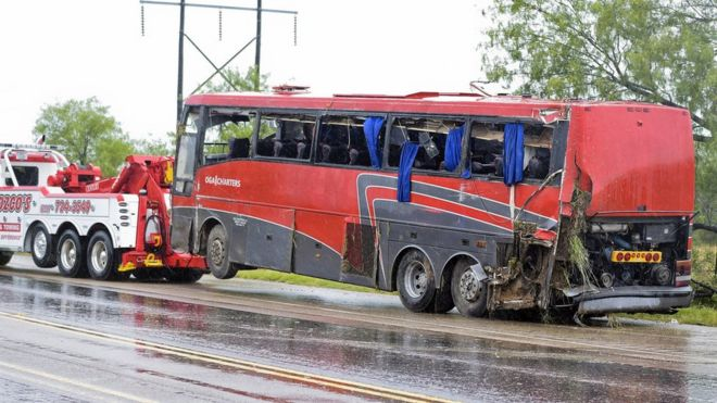 Damaged OGA Charters bus hauled away after fatal rollover in Texas on Saturday, May 14, 2016,