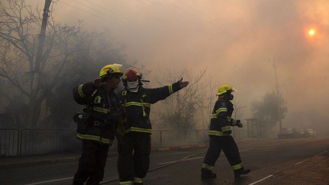 Fire fighters work in Haifa, Israel, Thursday, Nov 24, 2016