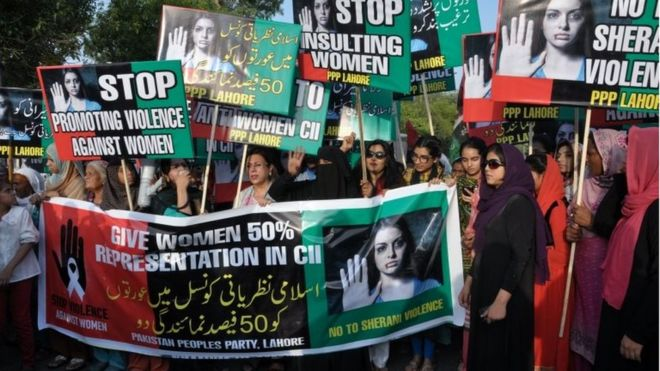 Supporters of Pakistan People's party rally to condemn violence against women, in Lahore, Pakistan, Friday, June 3, 2016.