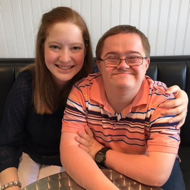 Picture of teenager Lillie and her friend Trevor who has Down's syndrome.