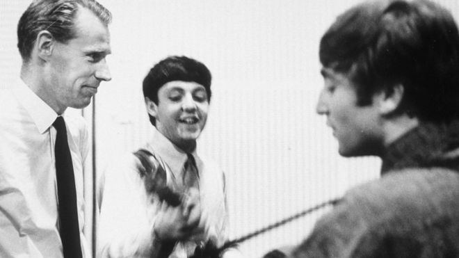 The Beatles in the studio with George Martin
