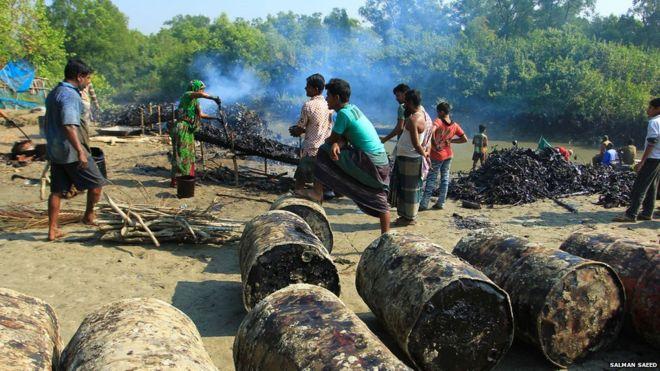 Oil being drummed