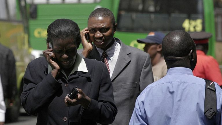 People using mobile phones in Nairobi