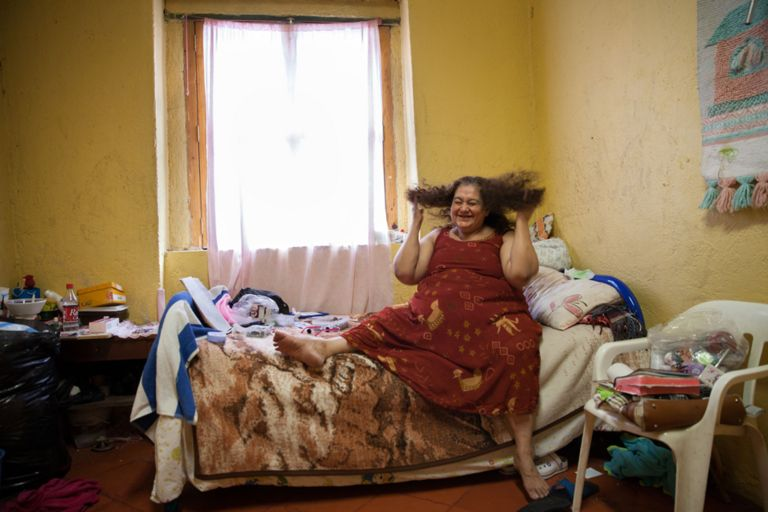 María Isabel, a resident of Casa Xochiquetzal, in her bedroom