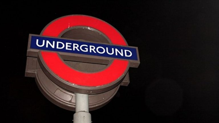 Underground sign at night