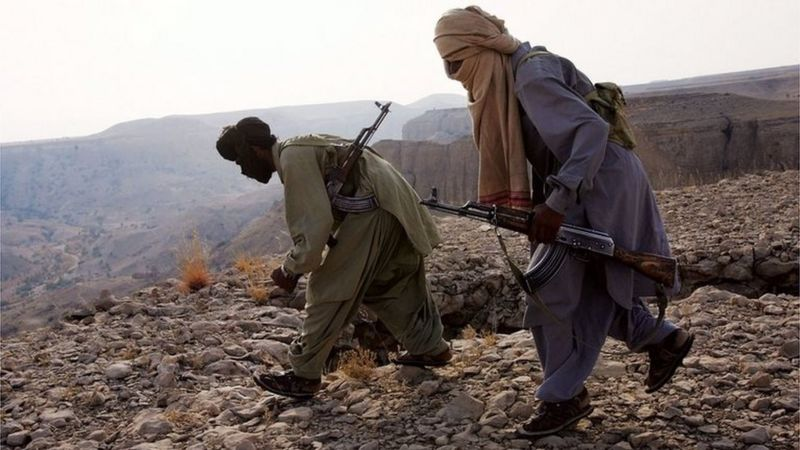 Marri tribal guerrillas prepare to attack a Pakistani troop outpost January 31, 2006 near Kahan in the Pakistani province of Balochistan.