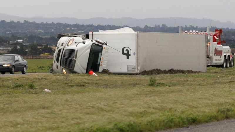 A lorry lies on its side after it was blown over by strong winds in Marina, California, on 17 February 2017