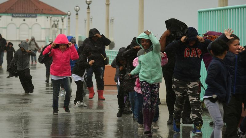 Schoolchildren caught in heavy rain in Los Angeles, California, on 17 February 2017