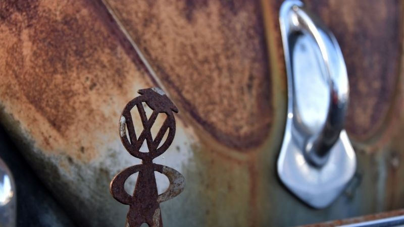 VW logo on rusty Beetle