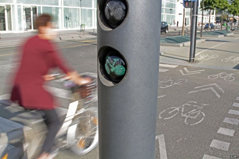 Cyclist in Paris at green light