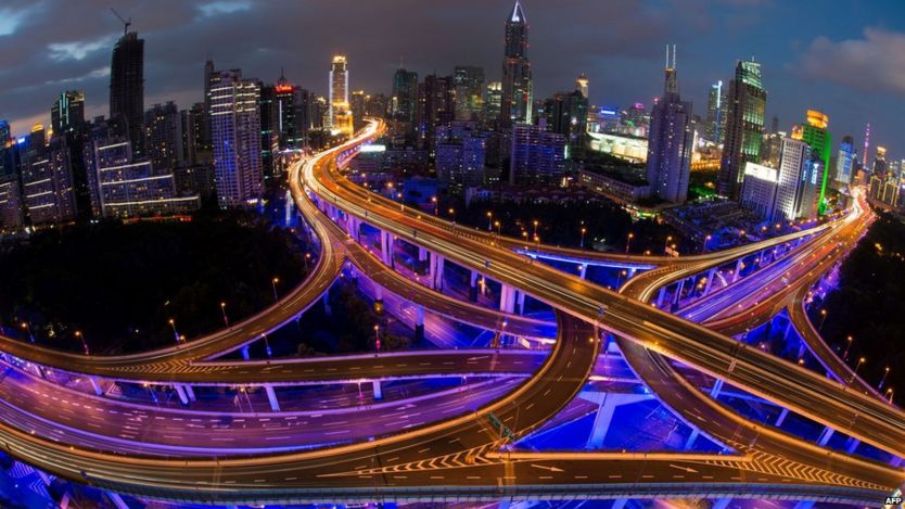 File photo: Roads and Shanghai's skyline, 30 September 2014