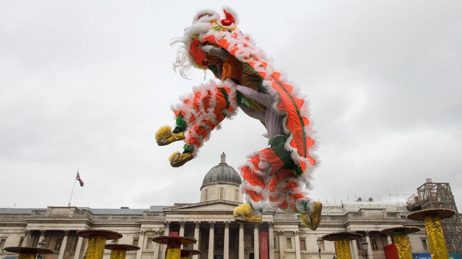 Dancers perform a Chinese flying lion dance in Trafalgar Square