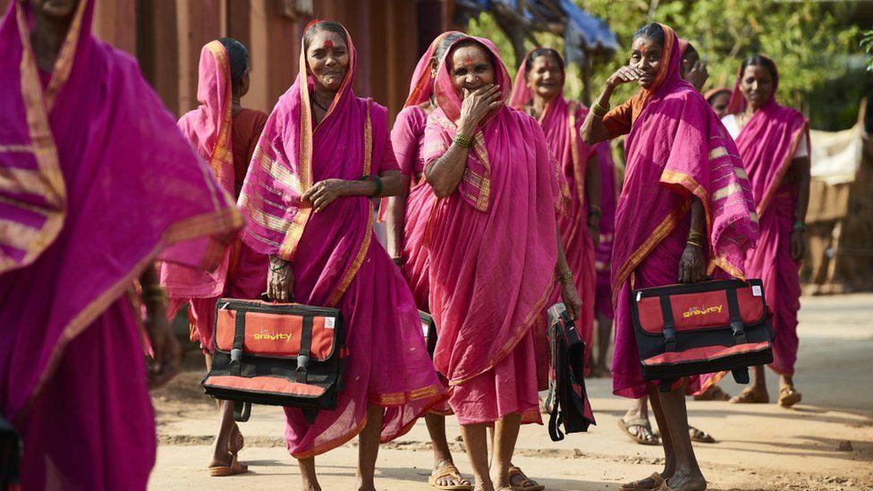 Women walk home from school