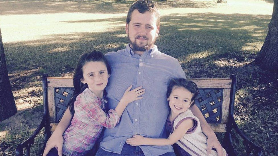 Daniel Shaver and his daughters