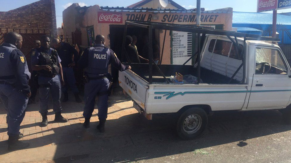 Police outside a shop near Pretoria, South Africa