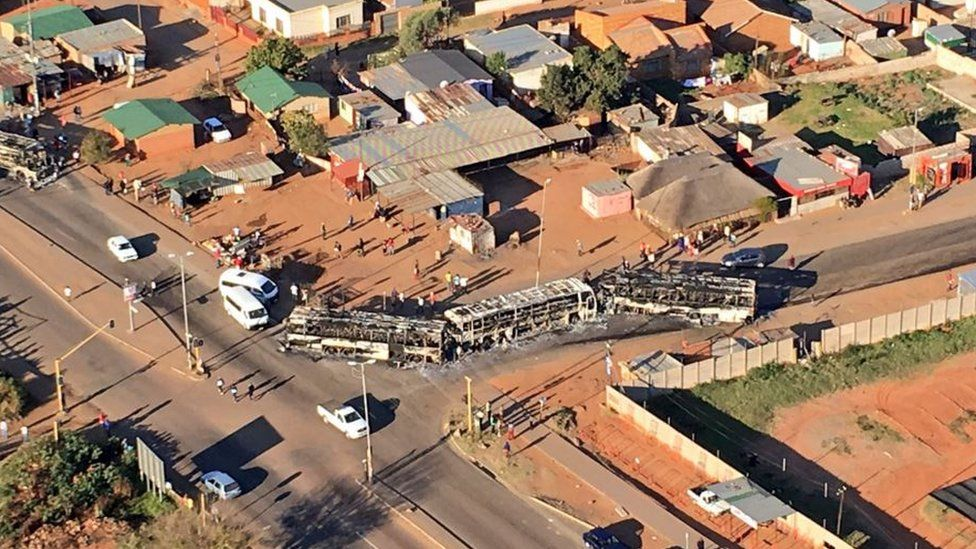 Aerial view of burnt-out buses near Pretoria, South Africa