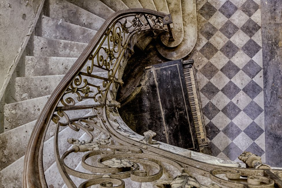 Abandoned staircase with piano