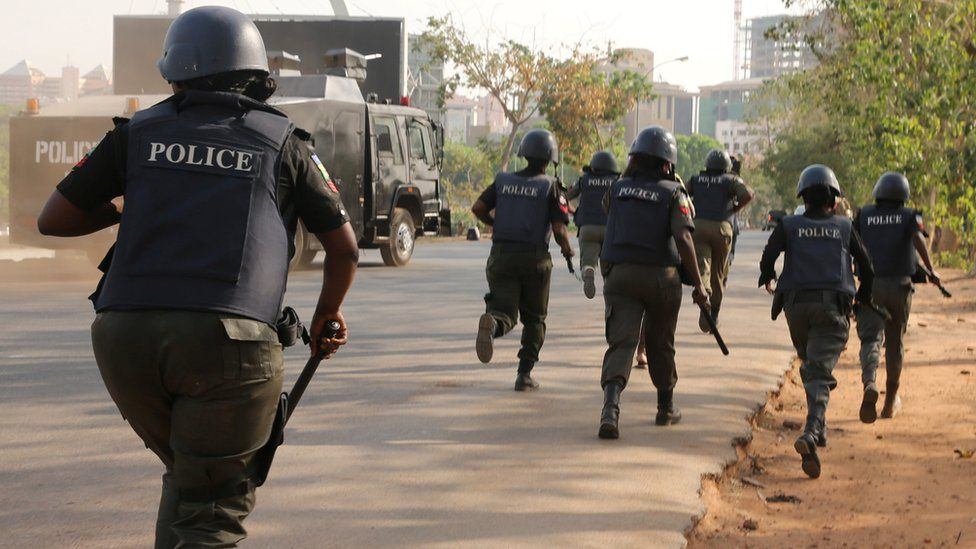 Riot-police in Abuja charging at a #BringBackOurGirls rally