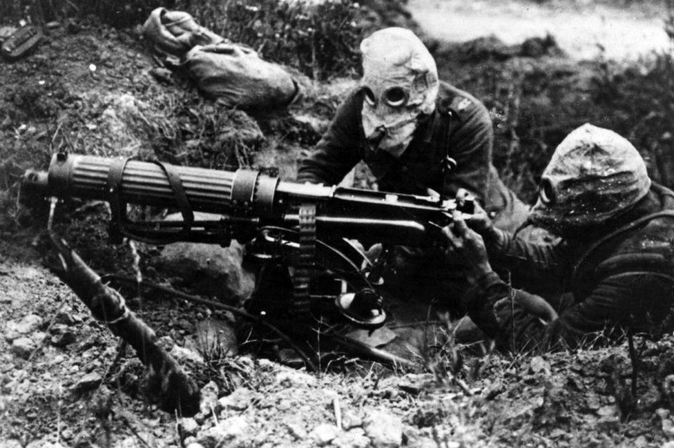 Photograph of gas-masked men of the British Machine Gun Corps with a Vickers machine gun during the first battle of the Somme