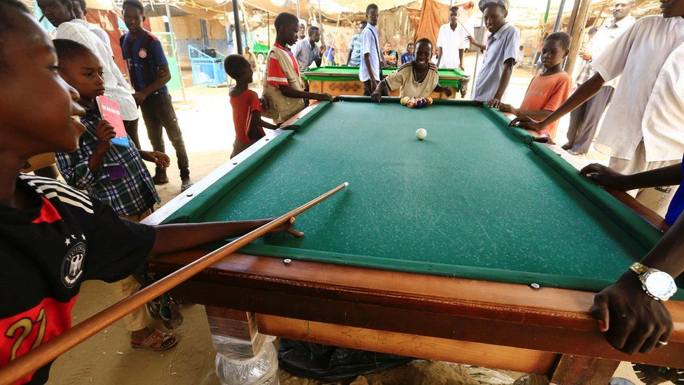 Children play pool in a camp in El-Fasher in Darfur, Sudan - Tuesday 6 September 2016
